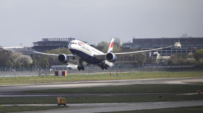 A British Airways plane takes off from the northern runway at Heathrow Airport. Picture: Steve Parsons/PA Wire