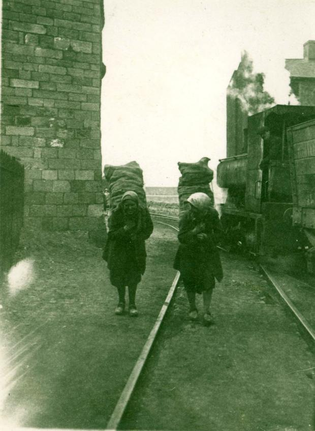 The Northern Echo: Two women with heavy backpacks in Barton quarry around 1900. The engine on the right appears to be Merrybent