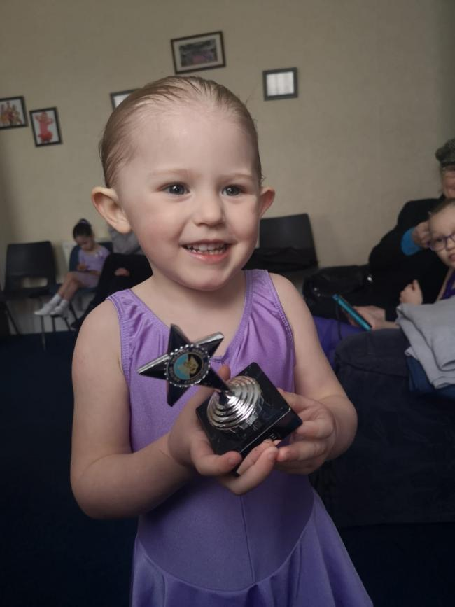 Chloe with her ballet trophy