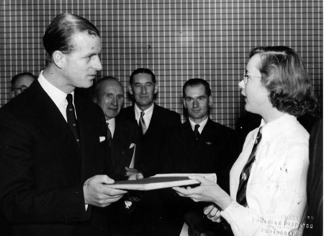 The Duke of Edinburgh accepts a gift for Prince Charles, who was then seven, from Darlington High School head girl Barbara Stafford when he opened the school on November 15, 1955