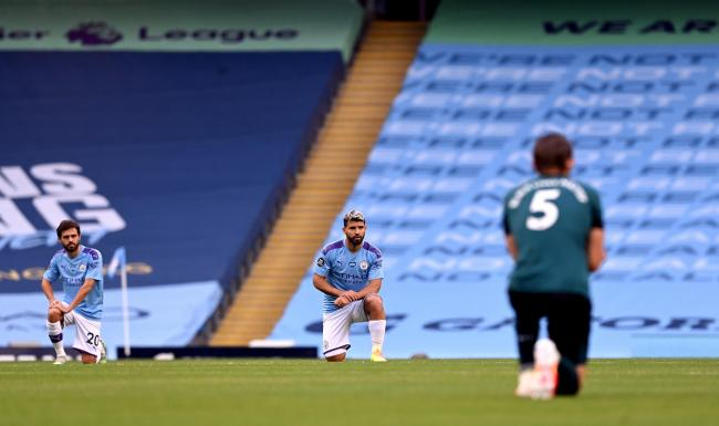 Manchester City's Sergio Aguero takes a knee in support of the Black Lives Matter movement before the Premier League match at the Etihad Stadium, Manchester Picture: Shaun Botterill/PA