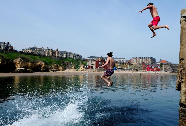 File photo of people 'tombstoning' into the sea at Cullercoats in North Tyneside Picture: PA Wire