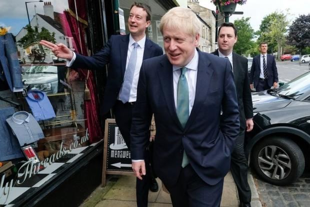 Simon Clarke, left, showing Prime Minister Boris Johnson and Tees Valley Mayor Ben Houchen around Guisborough 	         Picture: SIMON CLARKE MP