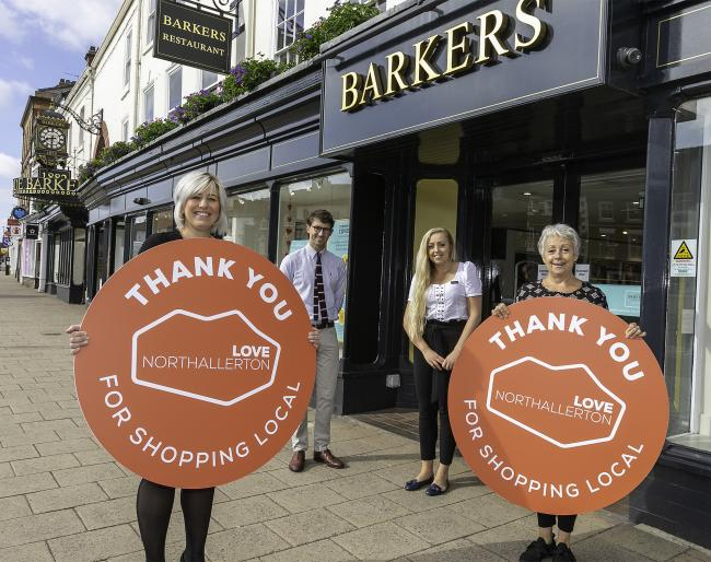 Staff at Barkers department store celebrating Love Northallerton's Shop Local campaign