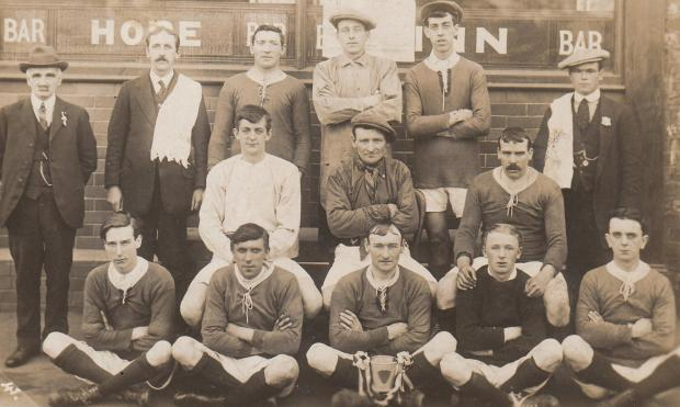 The Northern Echo: Players posing with a trophy outside the Hope Inn, in Yarm Road, Darlington. Any clues about the silverware on view?