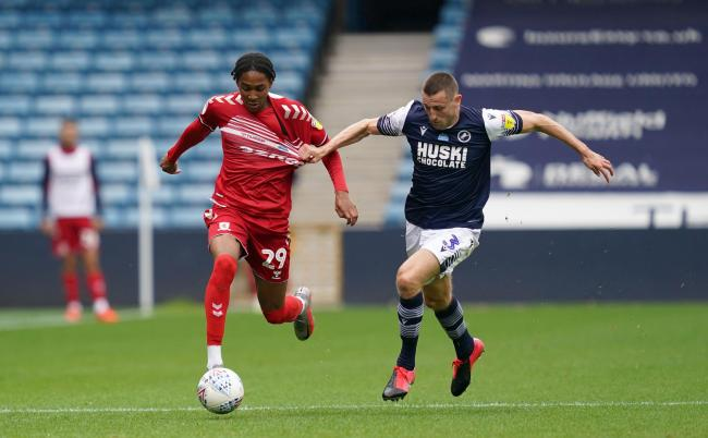 Djed Spence tries to shake off the attentions of Millwall defender Murray Wallace during Middlesbrough's midweek win at the Den