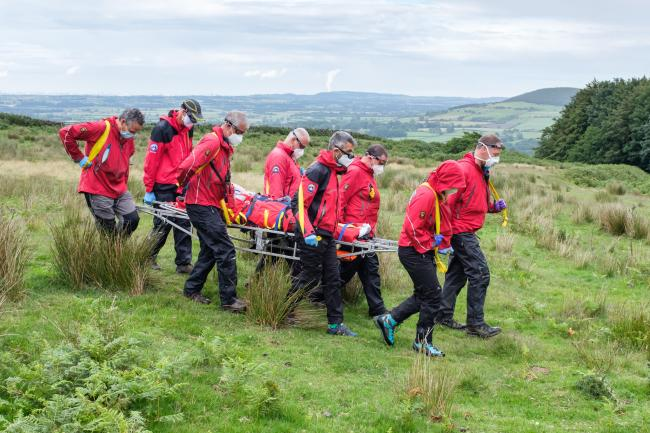 The walker is stretchered to an ambulance after falling whilst walking near Osmotherly