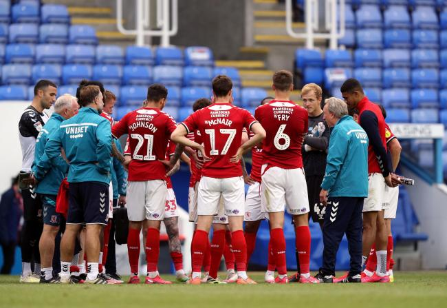 Neil Warnock speaks to his players in the wake of Middlesbrough's crucial 2-1 win at Reading on Tuesday night