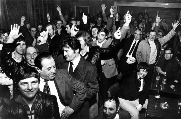 The Northern Echo: Hands up for those who want to stay out on strike: inside the Darlington & Simpson Rolling Mills Club & Institute as a vote was taken in February 1980.