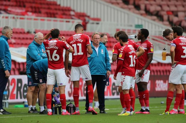 Neil Warnock talks to his Middlesbrough players during Saturday's 3-1 defeat to Cardiff City