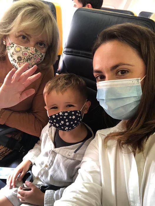 Rebecca Laws, with her son Theo, 3, on the plane to Spain on Friday