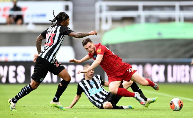 Miguel Almiron slides in against Andy Robertson (Picture: PA Wire)