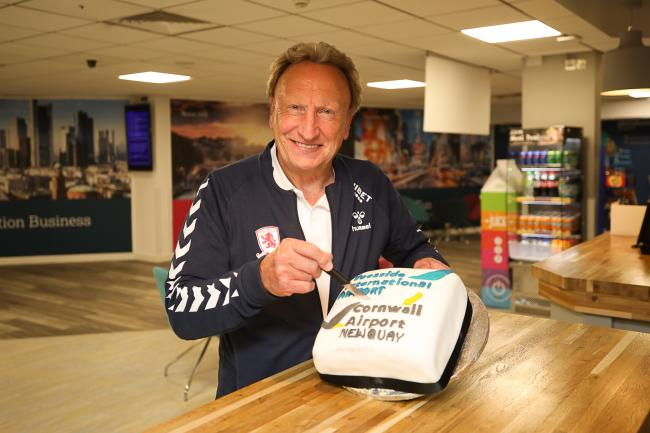 Neil Warnock cutting the Newquay route cake