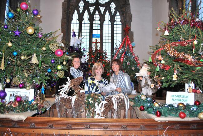 Popular television newscaster Pam Royal and daughter Pip with church member Julia Rowsby at a recent tree festival