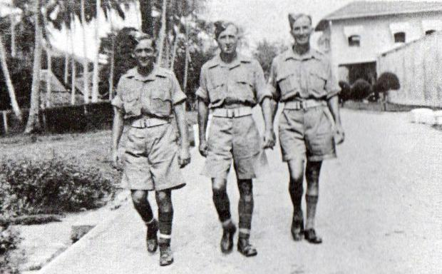 The Northern Echo: Three of Harry Innes' friends out for a walk in his camp in Malaya