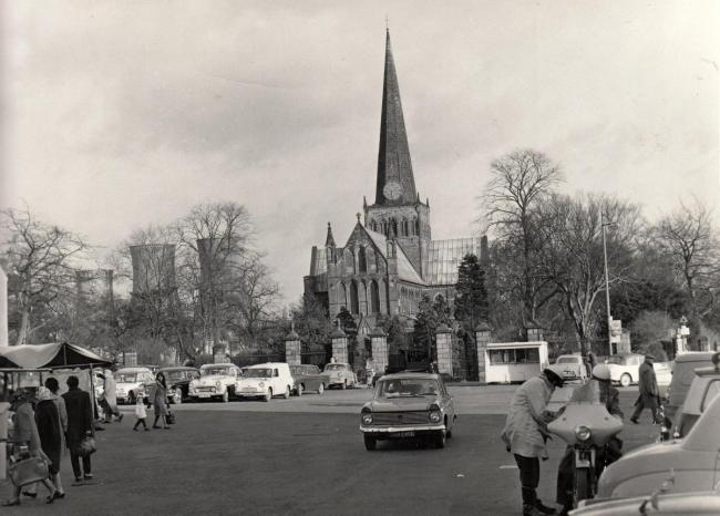 St Cuthbert's from the Market Place in 1964 with the three cooling towers of the Haughton Road power station behind. It also looks like this photo was taken on a market day. Remember when the view looked like this? Remember when you could drive acro