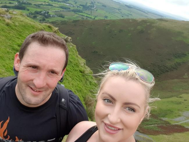 Alexandra Ellis and her partner Darren Brown climbing Blencathra in the Lake District