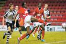 GOAL THREAT: Crewe striker Clayton Donaldson fires in a shot as Darlington's Ian Miller, left and Alan White look on