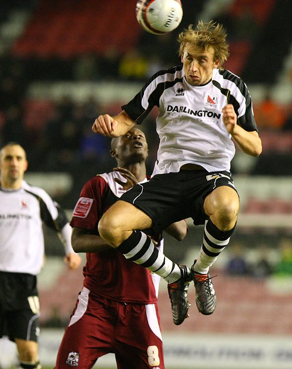FULL FORCE: Darlington's Gareth Waite gets his head to the ball. Picture: TOM BANKS