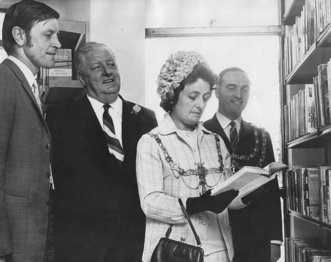 The opening of Cockerton library on September 2, 1970, with mayoress Doreen Jackson drawing the first book of the shelves while her husband Eric, the mayor, looks on behind her. On the far left is David Dougan of the Northern Arts Association, who perform