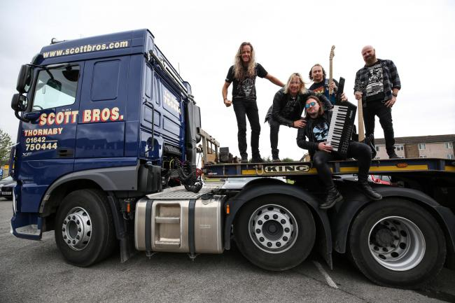 The Kill pose with Scott Bros' new 60-tonne low loader unit during their gig at Thornaby Sports and Leisure Centre.                                                                                            Picture: CHRIS BOOTH