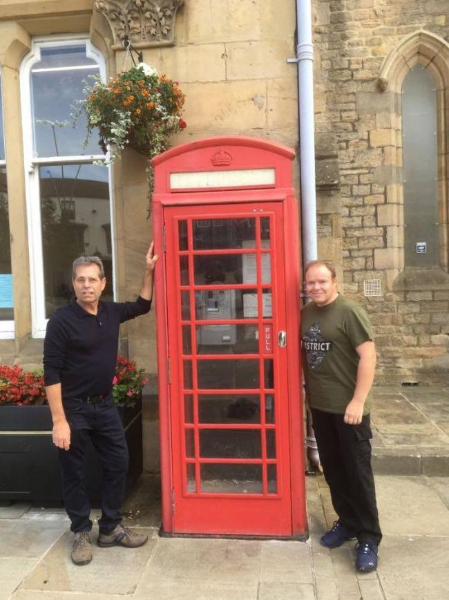 Cllr Sam Zair and Michael Oneill with the red telephone kiosk