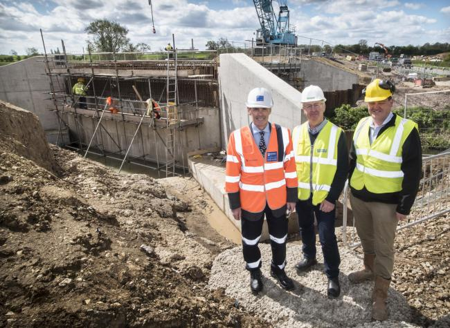 Work on the new Dalton Bridge progresses watched by (from left) County Councillor Don Mackenzie, Hambleton District Council Leader Councillor Mark Robson and Roy Fishwick, representing the group of businesses backing the bridge scheme.