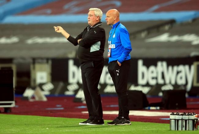 Steve Bruce chats with his assistant, Steve Agnew, during Newcastle United's 2-0 win at West Ham United on Saturday night Picture: ADAM DAVY/PA WIRE