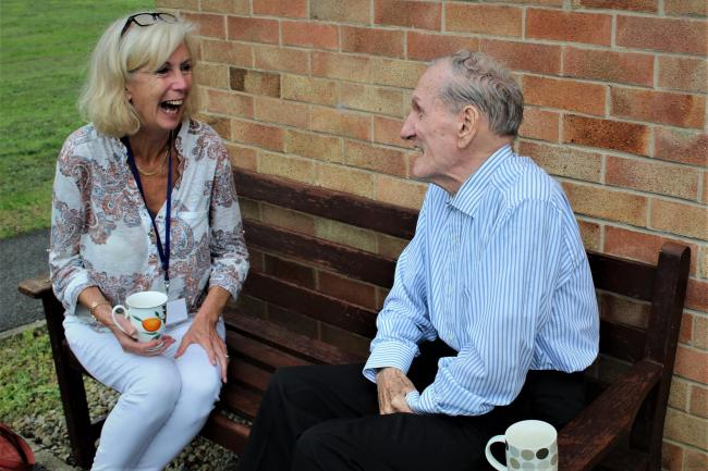 Maggie Cox, a dedicated volunteer befriender with Age Uk North Yorkshire and Darlington, enjoying one of her regular chats with 89-year-old John Wilkinson. Picture: Peter Barron
