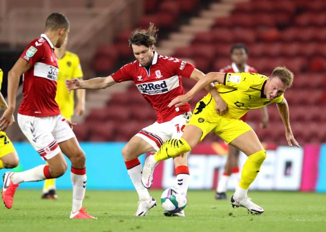 Barnsley's Cauley Woodrow (right) and Middlesbrough's Jonathan Howson battle for the ball during the Carabao Cup second round match at the Riverside Stadium, Middlesbrough
