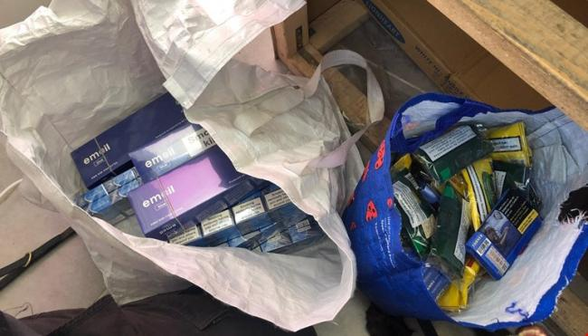 In total 383 packs (7,660 cigarettes) and 2.55 kg hand rolling tobacco (51x 50g packs) were seized from the premises