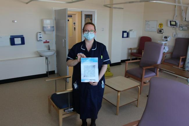Rachel De Silva, assistant senior clinical matron, with a QR code, which will be displayed in hospitals so people can provide details for track and trace