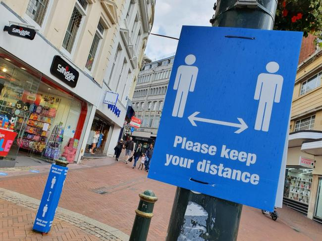 A sign reminding people to socially distance during the coronavirus pandemic in Bournemouth town centre