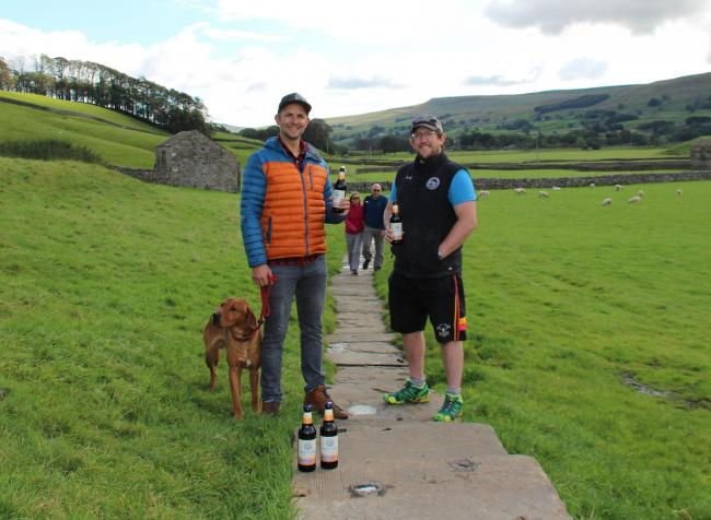 Bolt the dog, Stu Taylor and James Law, with ramblers approaching, on the Pennine Way