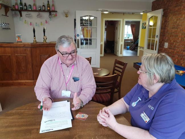 Geoff Newton from Healthwatch Stockton with a member of care home staff