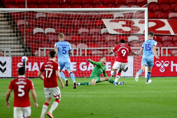 Middlesbrough's Britt Assombalonga (second right) scores his side's first goal of the game during the Sky Bet Championship match at Riverside Stadium, Middlesbrough