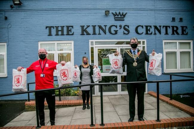 Paul South from MFC Foundation who was delivering food parcels to Caroline Todd from The King's Centre in Darlington, also pictured Darlington Mayor Chris McEwan. Picture: SARAH CALDECOTT