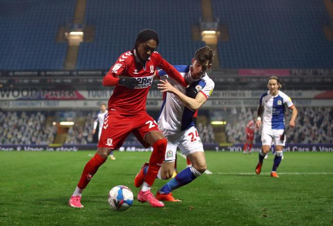 Wing-back Djed Spence tries to shake off his marker during Middlesbrough's midweek draw with Blackburn Rovers