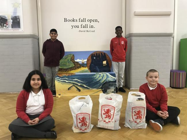 Ayresome Primary School children Adam, Fode, Shanya and Daniel with some of the Middlesbrough FC Foundation food parcels