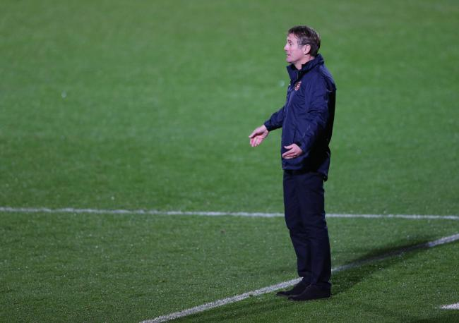 Phil Parkinson stands in the technical area at the Keepmoat Stadium
