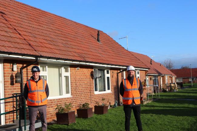 Gareth Hutchinson from ENGIE and Daryl Reed from believe housing with some of the finished homes in Woodhouse Close.