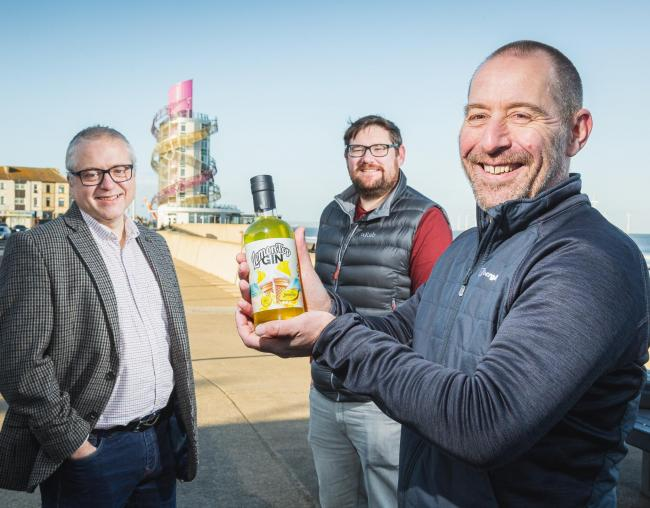 Steve Gill, Andy Mogg and Arron Stoutt with LemonTop Gin at Redcar beach