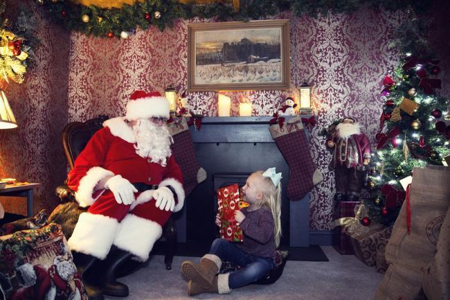 Santa's Grotto, like this one at the Bowes Museum Christmas Market, will be able to go ahead with new rules to reduce the risk of spreading the coronavirus, the Government has said. Father Christmas does not need to wear a mask, but children will no