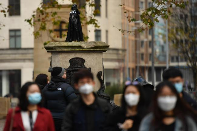 A Darth Vader figurine on the empty Edward Colston plinth in Bristol