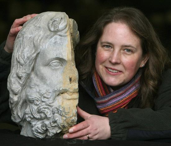 TREASURE JOVE: English Heritage curator Susan Harrison with the 1,800-year-old bust of the Roman God Jupiter found in the archaeological store in Helmsley