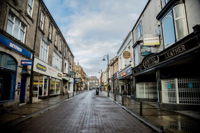 Newgate Street, in Bishop Auckland, seemed empty with most of the stores closed   Picture: SARAH CALDECOTT