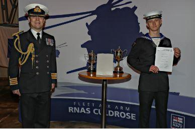 Naval Airman Cameron Vallance is congratulated by Captain Stuart Finn at his passing out parade