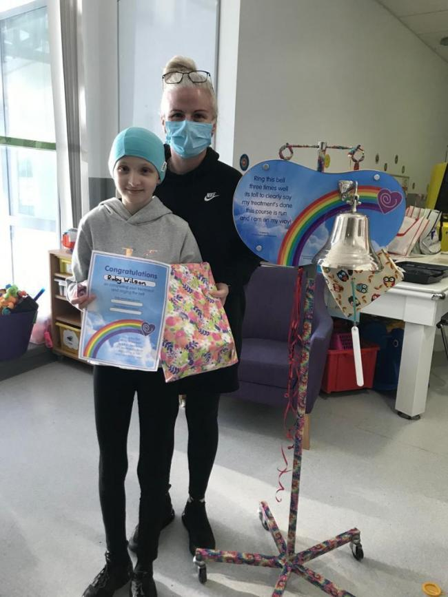 Ruby Wilson and mum Sarah ringing the bell to signify end of treatment