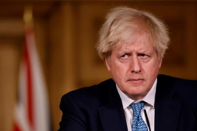 Prime Minister Boris Johnson during a Downing Street briefing - yesterday, he looked dishevelled and grim-faced as announced the latest terrible statistic