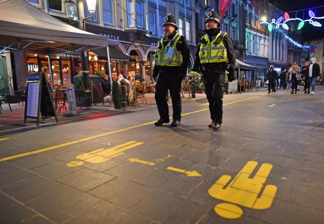 File photo dated 04/12/20 of police officers on patrol around cafes and pubs in Cardiff. Nine Metropolitan Police officers have been fined £200 each for breaching Covid-19 regulations for eating in a cafe while on duty, Scotland Yard has said. PA Ph